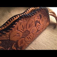 """Vintage hand tooled zippered clutch In nearly perfect condition, this hand tooled clutch is so American & cool! It is 8"""" wide and 4 1/2"""" tall. It is vintage and in excellent condition! Vintage Bags Clutches & Wristlets"""