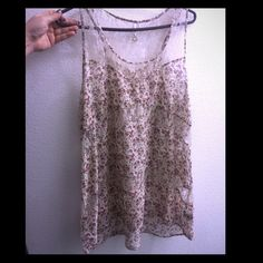 Floral lace tank top Floral and lace tank top. Fits like a large. Loose fitting wavy flow. Rue 21 Tops Tank Tops