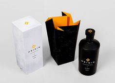 Origin Gin Packaging Turns an Emblem into the Box's Opening #paper #packaging trendhunter.com