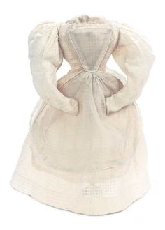 A beautiful cotton fabric with interwoven design has a rounded neckline,fitted bodice,cartridge-pleats at the skirt waist and exuberant Juliette sleeves that achieve their shape from generous cartridge pleats at the shoulders and tapering lower sleeves. Included is a tablier of fine sheer muslin with self-piping and lace-edging. Circa 1840.