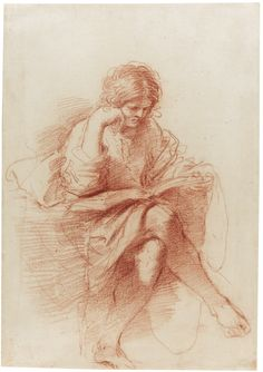 Giovanni Francesco Barbieri, called Il Guercino (CENTO 1591 - 1666 BOLOGNA) -  A SEATED YOUTH READING, HIS HEAD RESTING ON HIS RIGHT HAND (STUDY FOR THE PROPHET ZECHARIAH) Red chalk, 304 by 212 mm
