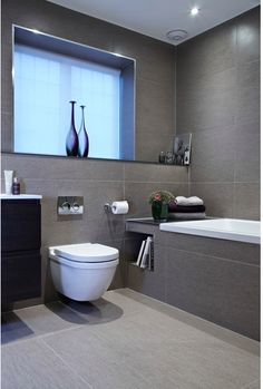 Bathroom Renovation Ideas: bathroom remodel cost, bathroom ideas for small bathrooms, small bathroom design ideas Bathroom Inspiration, Gray And White Bathroom, Bathroom Makeover, Grey Bathroom Tiles, Bathroom Interior Design, Gray Bathroom Decor, Small Bathroom Remodel, Modern Bathroom Design, Bathroom Layout