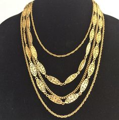 Vintage multi strand gold tone chains necklace Faux filigree ovals links mix with goldtone chains Decorative end caps Lengths are 28 inches long, can be sho. Gold Jewelry, Vintage Jewelry, Jewelry Accessories, Unique Jewelry, Vintage Necklaces, Silver Charm Bracelet, Silver Charms, Necklace Set, Gold Necklace