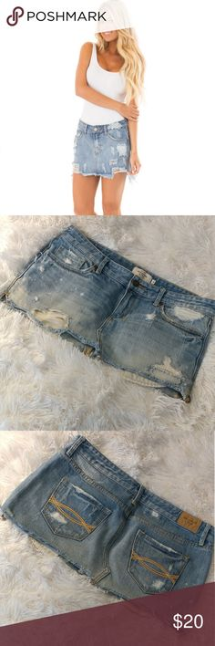 Abercrombie & Fitch Distressed Denim Skirt Excellent condition. Abercrombie & Fitch distressed denim skirt. Mid rise. Size 4/27. (Actual skirt is 2nd and 3rd photo)  * I do not do trades * Abercrombie & Fitch Skirts