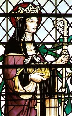 Stained glass window depicting Hilda of Whitby http://www.missionstclare.com/english/people/nov18.html above address documents the saint
