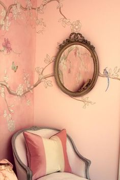 Beautiful painted wall, an oval gilt mirror and an old fashioned arm chair