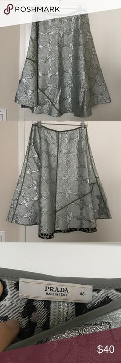 Beautiful Prada skirt Bought this from a consignment store for my mom but she didn't like it so here it is. MIDI length size 46 in U.K. Size. Waist measures 31 inches. Length is 25 inches. Pastel green and silver color. Prada Skirts Midi
