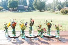 Simple Table Display - Rustic Wild Flowers in Mason Jars and Log Centerpieces.