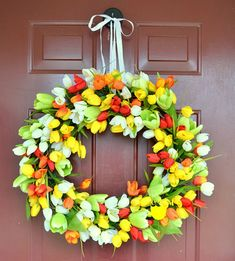 Spring Tulip Wreath: Greet guests with lush, colorful tulips this Easter. Click through to find more DIY Easter wreath ideas for your front door. Diy Spring Wreath, Easter Wreaths, Diy Wreath, Holiday Wreaths, Wreath Ideas, Holiday Crafts, Holiday Decor, Make Your Own Wreath, How To Make Wreaths