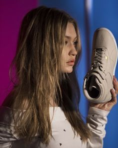 wholesale dealer 09f77 461cd Gigi Hadid fronts the Spring 2018 Reebok Classic campaign and sports the  new Freestyle Hi design.