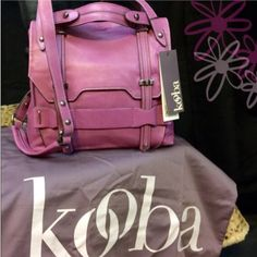 """Kooba Jane Crossbody Bag Gorgeous NWT Kooba bag in violet. Worn once for a photo but otherwise not used. Dustbag included. Some storage wear on magnetic pocket closure area and a few storage scuffs but nothing major.  Features: Leather Plainweave lining Magnetic closure 20"""" shoulder drop 11.5"""" high 12"""" wide Strap is adjustable from 19.25"""" to 20"""" Dimensions: 14.4 x 11.8 x 2.9 inches; 1.5 pounds Weight: 1.9 pounds.  NO TRADES. Reasonable offers accepted via the offer button below. Kooba Bags…"""