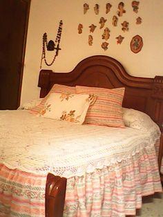 El tendido tejido de la cama de mi Madre .