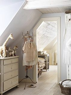 Attic bedroom - I have bedroom walls and door jambs just like this. Pleasing to the eye but hard to work with. #CustomHomeBuildersRaleigh