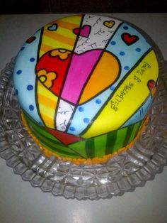 Chocolate cake, filled with chocolate ganache and chocolate drops, covered with fondant. Hand painted copying a piece of Romero Britto. Love the concept anc color of his work.