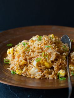 Kimchi Fried Rice - Spoon Fork Bacon 1 ½ tablespoons sesame oil 2 eggs, lightly beaten 2 ½ cups steamed rice 1 ½ cups kimchi, chopped (with its juices) 3 tablespoons low sodium soy sauce 2 green onions, thinly sliced 2 1/2 tsp toasted sesame seeds