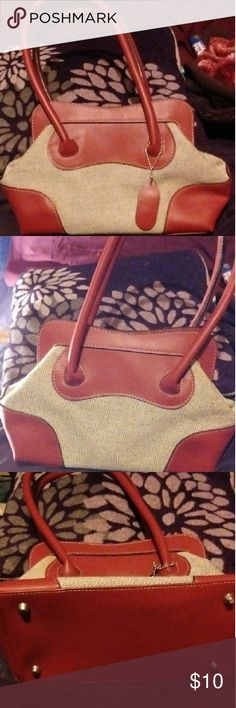 Cute little purse It's a cute little purse that you can carry on your arm or shoulder. It's in great condition and shape. It's has red handles and has like checked details Bags