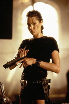Pin for Later: Oops, We Did It Again . . . 31 Millennial Costumes That Are So Fetch Lara Croft: The Inspiration Angelina Jolie used her tough-girl qualities to play a perfect Lara Croft in Tomb Raider.