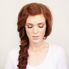 long haired lovers rejoice with this fishtail braid | learn how to do these simple & stunning hairstyles here: http://www.mywedding.com/articles/wedding-hairstyles-for-bridesmaids/