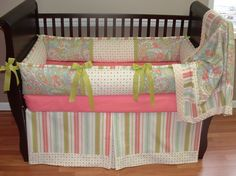 Spring Tailored Baby Bedding  Included in this set is the bumper, blanket, and crib skirt.  There is lots of detail in this custom set including soft off white minky, green grosgrain ties, coordinating cotton prints in paisley, stripe and polka dots too.