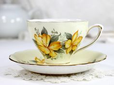 Colclough Buttery Yellow Cup and Saucer, Vintage English Teacup. Slender footing and gilt trimmed, this set features a yellow Iris type of floral decoration. Beautiful against the buttery background s