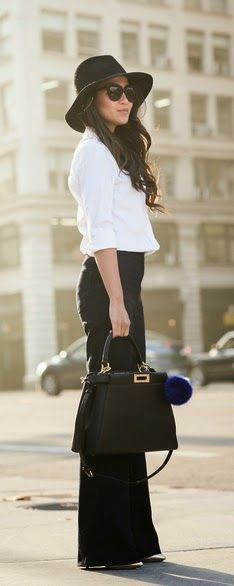Street style black trousers, hat and white blouse