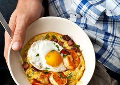 shrimp and grits with tasso. topped with fried egg.