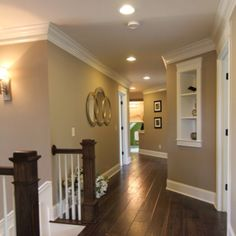 dark hard wood floors and dark stair posts with white spindles!