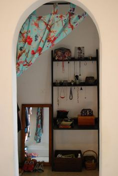 Katie's Cozy Teeny Tiny Boho Studio @StrubeLaura fabric in arched door way.  Check out the whole site.  Very you.