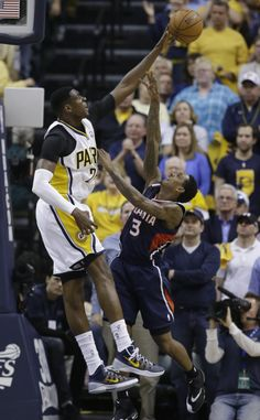 Atlanta Hawks' Louis Williams (3) has his shot blocked by Indiana Pacers' Ian Mahinmi (28) during the second half in Game 2 of an opening-round NBA basketball playoff series Tuesday, April 22, 2014, in Indianapolis. Indiana defeated Atlanta 101-85. (AP Photo/Darron Cummings)