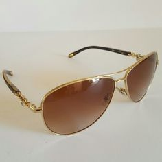 Tiffany and Co Sunglasses Authentic Tiffany and Co Sunglasses  Excellent condition   Store display  Gold and brown frame  Lenses have some scratches  Includes original case Tiffany & Co. Accessories Sunglasses