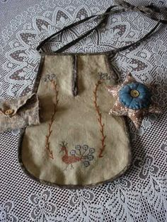 Primitive sewing pocket with star pincushion and sewing roll