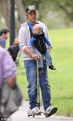 Jamie Oliver and son Buddy on a micro scooter...