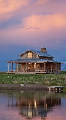sweet lil cabin on the lake with a wrap around porch.....what a place to sit back and relax!