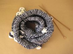 This self-knitted loop scarf is warm, wide and integrated with sweet pompoms. Material: Lana wool, acrylic, nylon Colour: Black (anthracite), white Washable at hand wash GR: About diameter 59 cm wide 30 cm Shops, Loop Scarf, Etsy Shop, Wool, Halloween, Tents, Halloween Stuff, Retail Stores