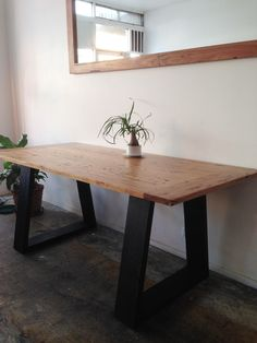 Recycled timber large desk/small dining table with contrast angled black legs by…