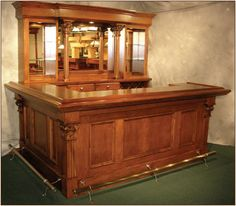 I like the shape of this bar and the cabinet with it. Would like a darker color though. (would use this bar but the colors of the other bar)