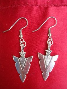 Silver plated arrowhead earrings. 2 bucks off! Only $9.49 Click on pic for details.