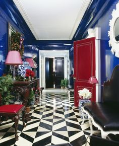 Miles Redd...Can you say wow?  Cobalt blue lacquered walls, black and white marble floors, pops of red accents on the door and chairs.  Amazing!
