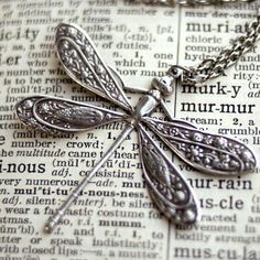 Victorian dragonfly stamping measuring 41mm tall and 50mm wide. Antiqued sterling plated. On 24 inches of silver plated chain finished with a lobster clasp.