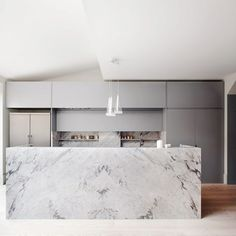 This marble's varying grayscale serves as the main centerpiece of this modern London kitchen.