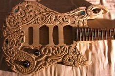 Here's a custom carved guitar by Kiwi boy Cowan. Awesome looking design.