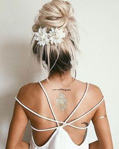 Im calling this a messy bun with a purpose. The flower barrettes (easily hacked or made) add an extra detail to a messy top knot. Even the long dark roots add charm to this style.