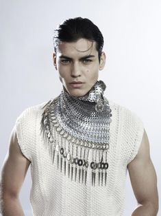 judy blame, cool shawl necklace for me. guys please wear sleeves or no shirt at all. No one is interested in your armpits.