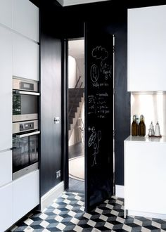 Chalkboard door and geometric tile, stacked ovens Cosy Kitchen, Happy Kitchen, Black Kitchens, Home Kitchens, Black And White Interior, Contemporary Interior Design, Interior Design Inspiration, Home Furniture, Kitchen Design