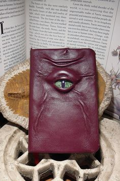Mythical Beast Book (Burgundy leather with Green eye) via Etsy.