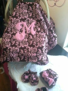 custom car seat canopy made of fleece, monogrammed with matching boutique style hat, mittens and booties all with handmade flowers and bows