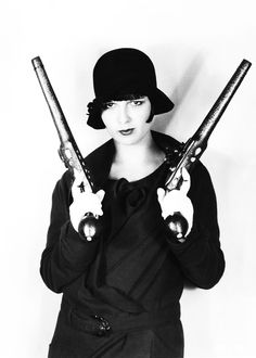She still loves me, Louise Brooks with Guns. A flapper with shooters: oh my! Flapper Girls, Flapper Era, Flapper Dresses, Louise Brooks, Roaring Twenties, The Twenties, John Galliano, Dior Couture, Bonnie N Clyde
