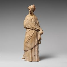 Terracotta statuette of a draped woman - Hellenistic, 3rd century BC