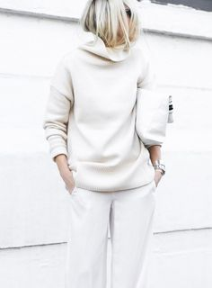 A white oversize turtleneck is paired with wide-leg jeans, a clutch, and stacked silver jewelry  #promagain #resale #consignment #cheap #prom #formal #dresses