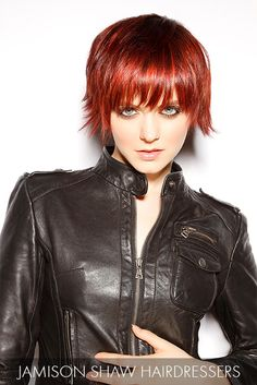 Fiery red strands are smooth, straight and to the point in this cropped cut that's as edgy as it is sensationally sexy.